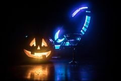 Halloween pumpkin orange cocktails. Festive drink. Halloween party. Funny Pumpkin with a glowing cocktail glass on a dark toned fo royalty free illustration
