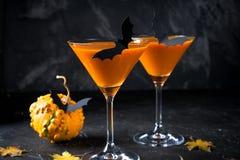 Halloween pumpkin orange cocktails. Festive drink. Halloween party. Pumpkin with holiday decorations. Halloween pumpkin orange cocktails. Festive drink stock photos