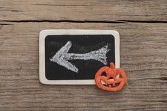 Halloween. Pumpkin over black chalkboard royalty free stock photos