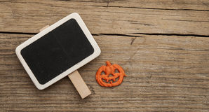 Halloween pumpkin over chalkboard. Stock Photography