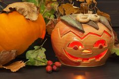Halloween pumpkin party, Big terrible Pumpkin lighten and reflection on wooden table background. Stock Images