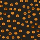 Halloween pumpkin pattern. Seamless vector holiday background. Orange grinning pumpkin lanterns on black backdrop Stock Photos