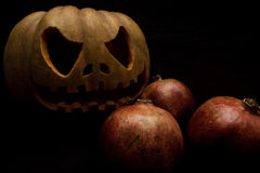Halloween pumpkin and pomegranates Royalty Free Stock Images