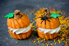 Halloween pumpkin recipe - orange cupcakes in the shape of pumpk Royalty Free Stock Image