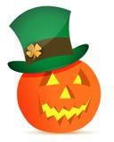 Halloween pumpkin and saint patricks hat Stock Image