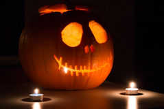 Halloween pumpkin. Scary Halloween pumpkin with candels. Scary glowing face trick or treat Royalty Free Stock Images