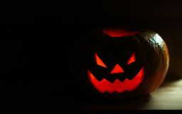 Halloween pumpkin with scary face. On black background royalty free stock image