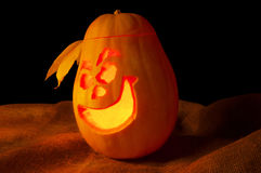 Halloween pumpkin with scary face and evil eye Royalty Free Stock Photo