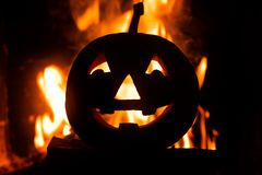 Halloween pumpkin with scary face on fire background. stock images