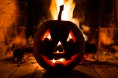 Halloween pumpkin with scary face on fire background. royalty free stock photography