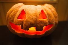 Halloween pumpkin with scary face. On table backgound stock images