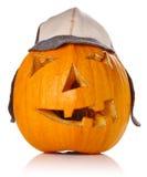 Halloween Pumpkin.Scary Jack O'Lantern in warm cap. On white background Stock Photos