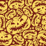 Halloween pumpkin seamless pattern. In retro style. Yellow pattern on a red background Royalty Free Stock Photography