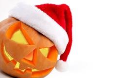 Free Halloween Pumpkin Shiny Inside Wearing Christmas Hat On White Ba Stock Image - 61985241
