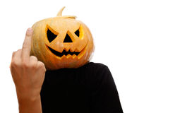 Halloween pumpkin showing middle finger. Halloween pumpkin Jack-O-Lantern on a white background showing middle finger to viewer royalty free stock photo