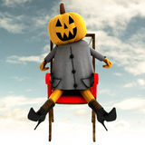 Halloween pumpkin sitting front view Royalty Free Stock Images