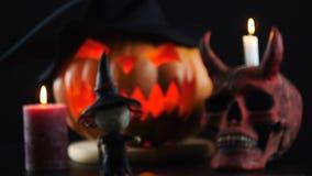 Halloween. Pumpkin, skull, candle, witch. Focus changes. Halloween. Pumpkin, skull candle witch Focus changes 4K stock video footage