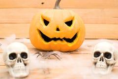 Halloween pumpkin and skulls Stock Image