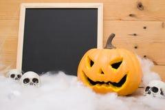 Halloween pumpkin and skulls Royalty Free Stock Photos