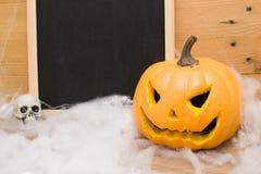 Halloween pumpkin and skulls Stock Images