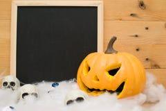 Halloween pumpkin and skulls Royalty Free Stock Image
