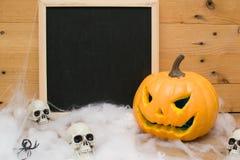 Halloween pumpkin and skulls Stock Photos