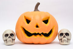 Halloween pumpkin and skulls Stock Images