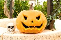 Halloween pumpkin and skulls Stock Photo