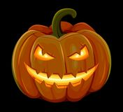 Halloween pumpkin is smiling. Isolated on black background Stock Image