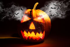 Halloween pumpkin with smoke on black background Royalty Free Stock Images