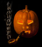 Halloween pumpkin  with smoke pipe a Stock Photos