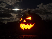 Halloween Pumpkin with Smoky Eye and the Full Moon Stock Photo