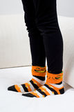 Halloween Pumpkin Socks Girl Sofa Stock Photography