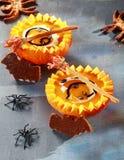 Halloween Pumpkin Soup Served in Half Pumpkins Royalty Free Stock Images