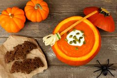 Halloween pumpkin soup with witches broom and bat bread snacks Royalty Free Stock Image