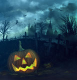 Halloween pumpkin in spooky graveyard. Halloween pumpkin in a spooky graveyard Royalty Free Stock Photography