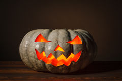 Halloween pumpkin standing on the wooden table Stock Photography