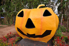 Halloween Pumpkin statue on grass in farm Royalty Free Stock Images