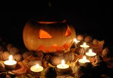 Halloween pumpkin still life with candles Stock Photos