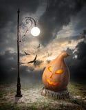Halloween pumpkin and streetlamp Royalty Free Stock Photos