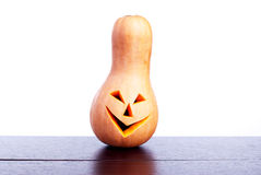 Halloween pumpkin on the table isolated on white background Stock Photo