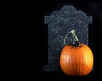 Halloween pumpkin tombstone Stock Photo