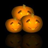 Halloween Pumpkin Trio Reflected Stock Photo