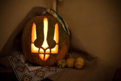 Halloween pumpkin in Ukraine. Tryzub. Coat of arms of Ukraine stock photography