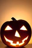 Halloween Pumpkin V1. Glowing Halloween Pumpkin Face grinning Stock Photo