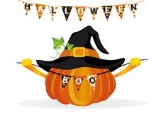 Halloween. Pumpkin in a velvet hat holds a garland with flags   Royalty Free Stock Images
