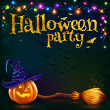 Halloween pumpkin and witch broom on dark background with colorful lamps garland, vector party flyer template Royalty Free Stock Photography