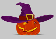 Halloween pumpkin and a witch hat Royalty Free Stock Photography