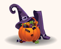 Halloween pumpkin with witch hat and boots Royalty Free Stock Photo