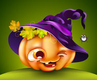 Halloween pumpkin with a witch hat. Funny Halloween pumpkin with a witch hat on green background Stock Images
